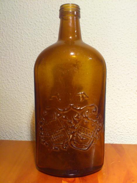 Botella LARIOS MÁLAGA Marrón. Muy antigua.Marca labrada en el propio cristal