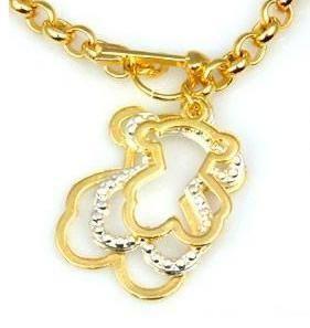 TOUS pulsera de Oro y un oso de Plata unica, monisima!!